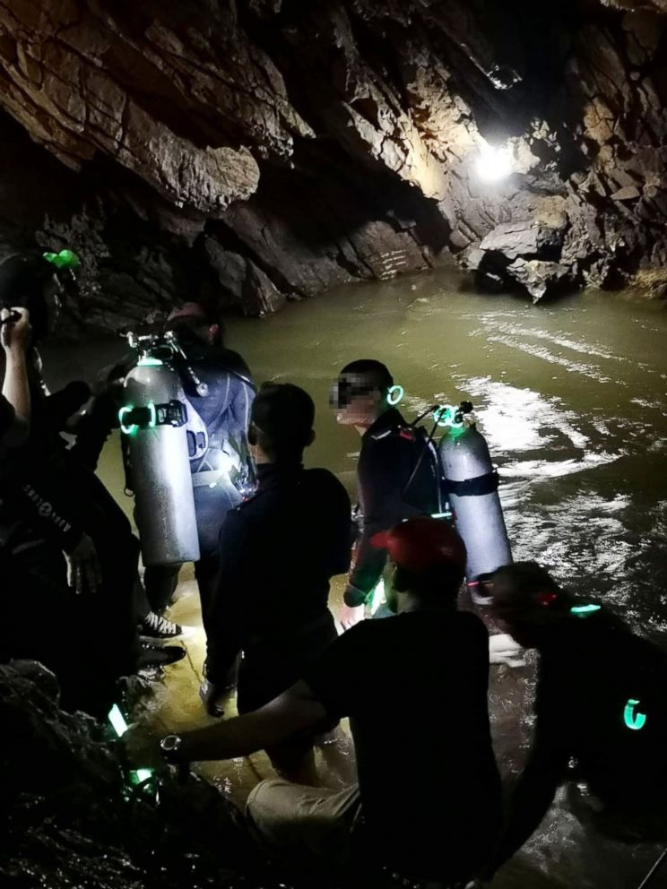 PHOTO: Divers work on a plan to rescue 12 boys and their soccer coach who remain trapped inside the Tham Luang Nang Non cave, Chiang Rai province, Thailand.