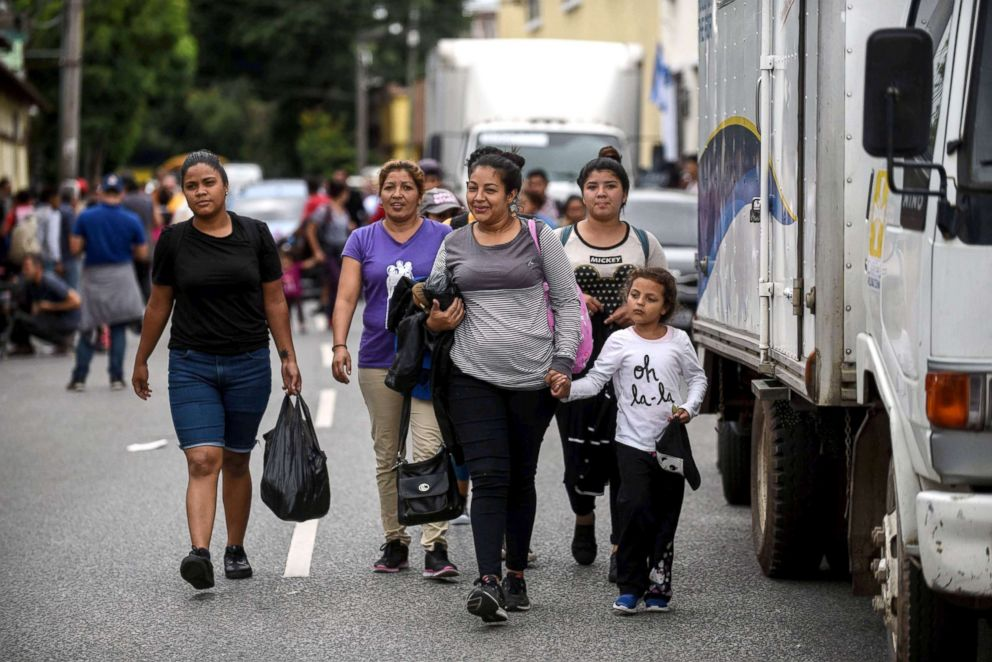 PHOTO: Honduran migrants taking part in a caravan towards the United States, leave the Casa del Migrante (Migrants House) in Guatemala City, Oct. 17, 2018.