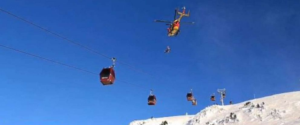 PHOTO: Skiers stranded in chair lifts at the Chamrousse ski resort in the French Alps, Dec. 24, 2017, are being rescued by helicopter.