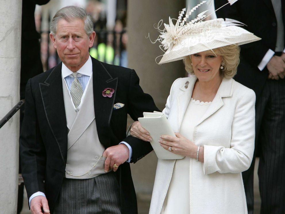 PHOTO: Prince Charles and his wife Camilla, the Duchess of Cornwall, depart the Civil Ceremony where they were legally married, at the Guildhall, Windsor on April 9, 2005 in Berkshire, England.