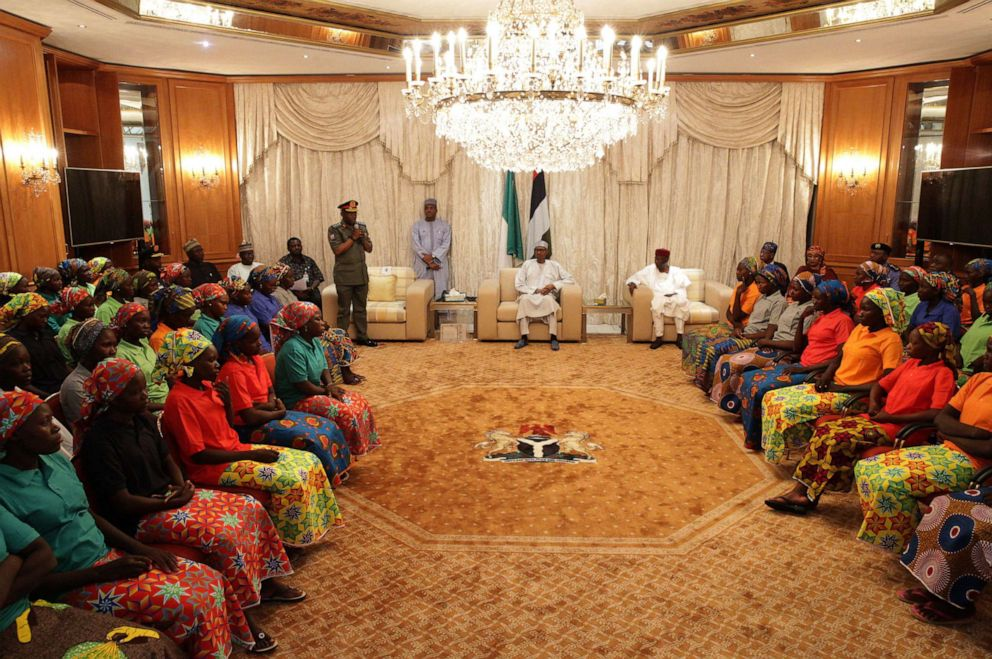 PHOTO: Relatives of abducted girls meet with President of Nigeria Muhammadu Buhari (C) after the releasing 82 of school girls, kidnapped by Boko Haram in Chibok back in 2014, at Aso Rock Presidential Villa in Abuja, Nigeria on May 7, 2017.