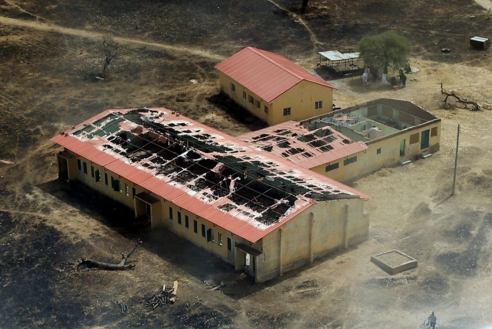 PHOTO: This picture taken on March 5, 2015 shows an aerial view of the charred classrooms of an all-girls boarding school in Chibok, northeastern Nigeria, where Boko Haram militants abducted 276 students on the night of April 14, 2014.