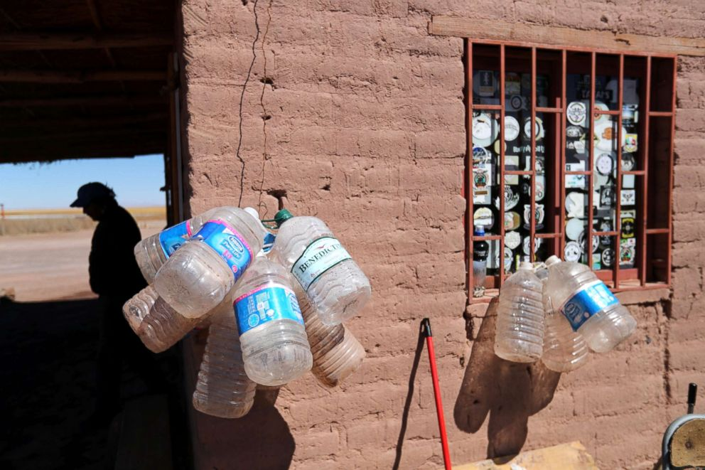 PHOTO: Empty water containers hang outside a mud house of a park ranger at Cejar lagoon at Atacama salt flat near San Pedro de Atacama, Chile, Aug. 15, 2018.
