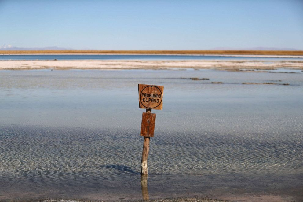 PHOTO: A sign reading No trespassing stands at Cejar lagoon at Atacama salt flat near San Pedro de Atacama, Chile, Aug. 15, 2018.