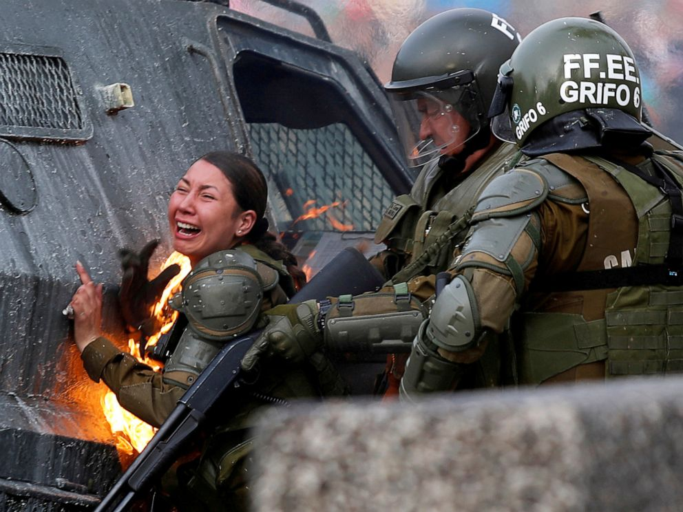 PHOTO: A riot police officer on fire reacts during a protest against Chiles government in Santiago, Chile, Nov. 4, 2019.