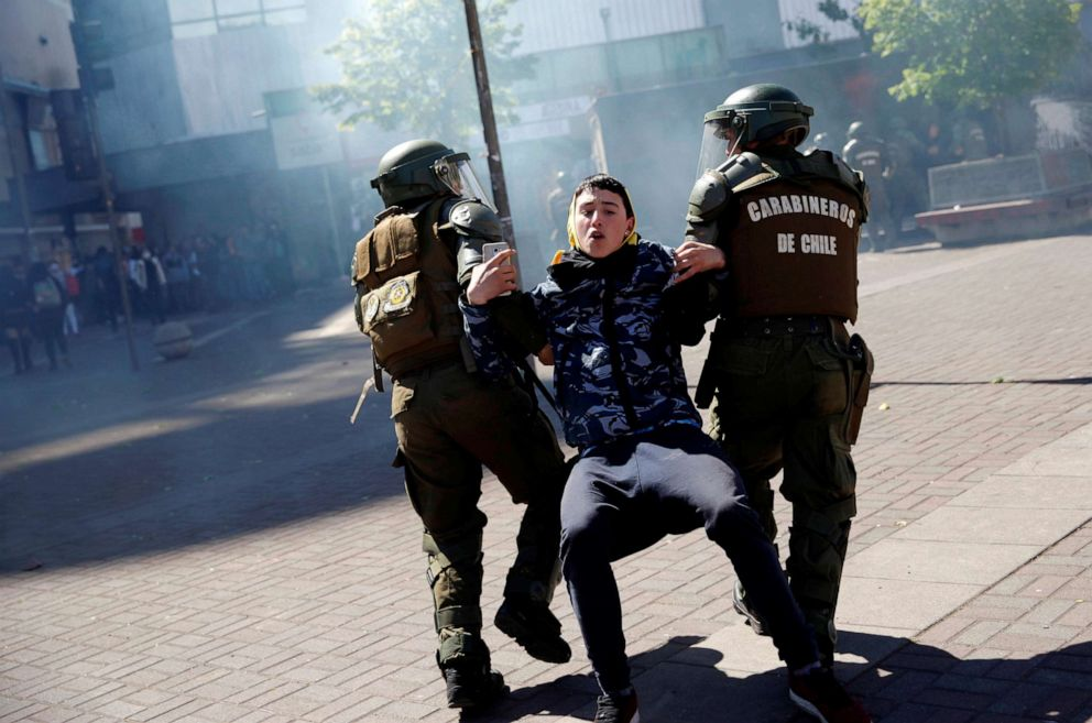 PHOTO: Officers of the Chilean police (Carabineros) detain a demonstrator during protests against Chiles government in Concepcion, Chile, Nov. 4, 2019.