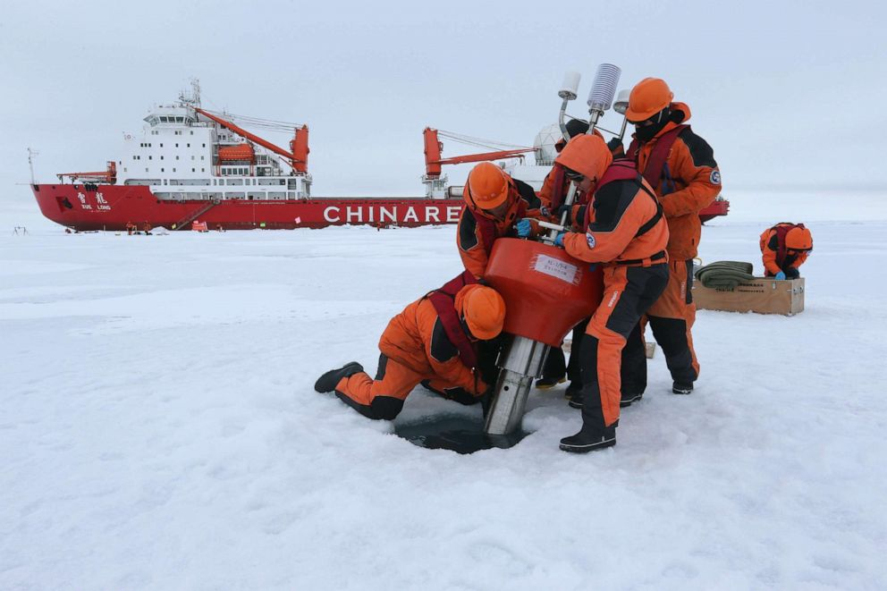 PHOTO: Members of Chinas research team set up an ocean profiling float at a short-term data acquisition location near the icebreaker Xuelong, or Snow Dragon, in the Arctic Ocean, Aug. 18, 2016.