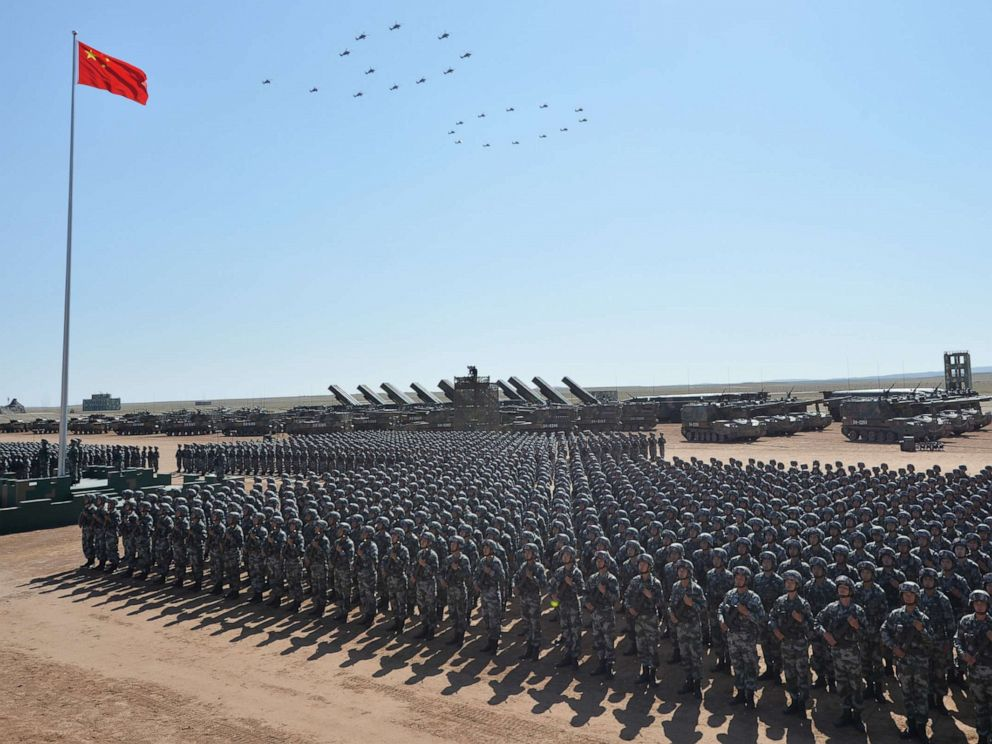 PHOTO: Officers salute during the military parade to celebrate the 90th anniversary of the founding of Chinese Peoples Liberation Army at Zhurihe training base in north Chinas Inner Mongolia Autonomous Region, July 30, 2017.