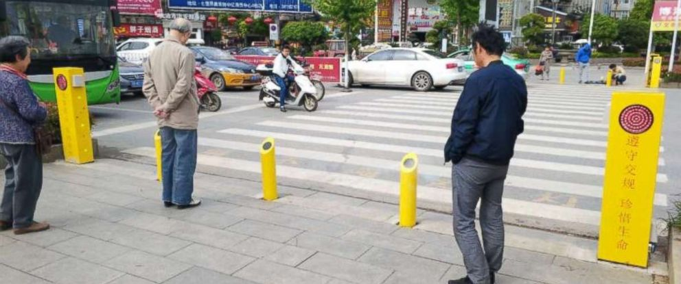 Jaywalkers risk being sprayed with water from posts if they try to cross too soon in Hubei province in central China.