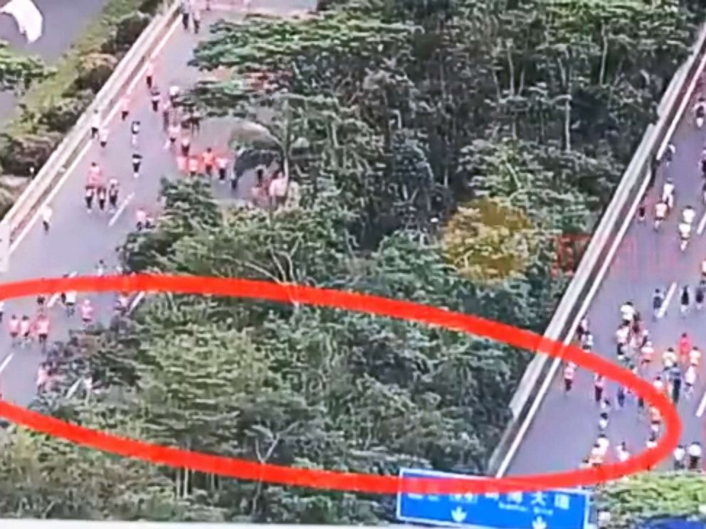 PHOTO: A traffic camera caught runners at a half-marathon in Shenzhen, China, cutting through foliage, shaving off about a mile and a half from the run, Chinese state news agency Xinhua reported on Nov. 29, 2018.