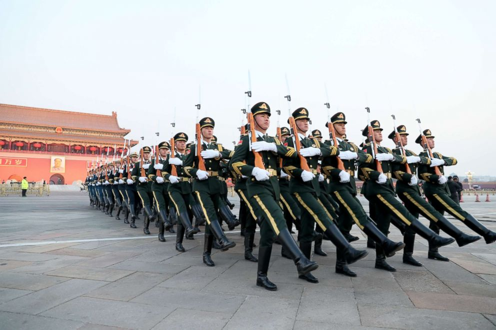 Army members march to the flagpole during the flag-raising ceremony at the Tiananmen Square on New Years Day Jan. 1 2019 in Beijing China