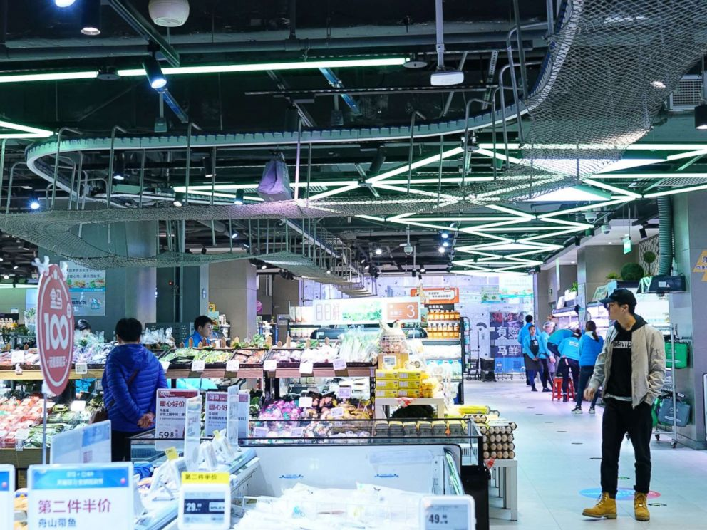 PHOTO: A conveyor belt carries a shopping bag filled with an online order across the ceiling at a store in Beijing, Nov. 7, 2018.