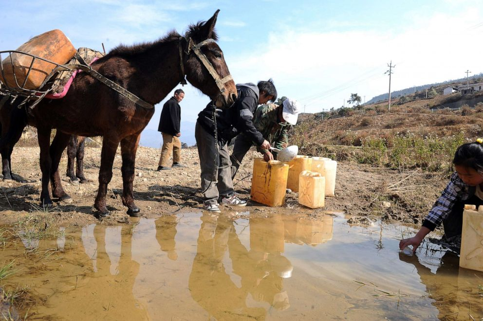 PHOTO: In this file photo, a caravan organized by local farmers fetch water on March 13, 2010, in Yanbian County of Panzhihua City, Sichuan Province, China.