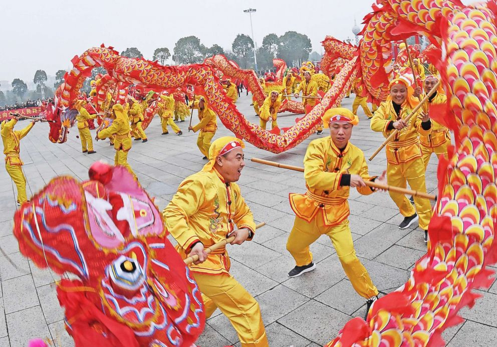 Folk artists perform a dragon dance at Renmin park in Yichun, east China's Jiangxi Province, Feb. 5, 2019.
