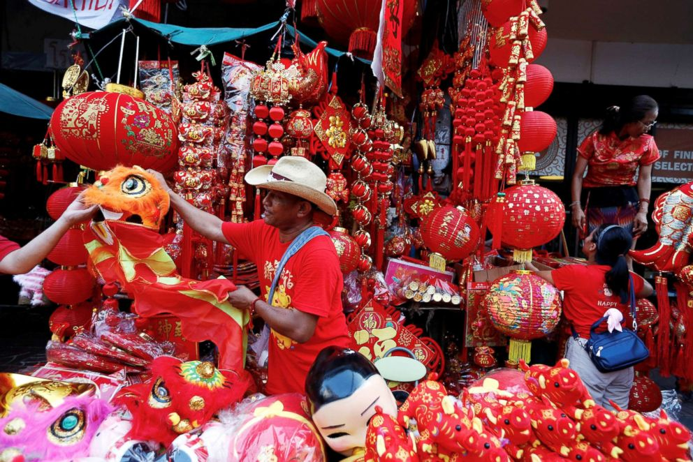 A man sells souvenirs in Chinatown during the Chinese Lunar New Year in Bangkok, Feb .5, 2019.