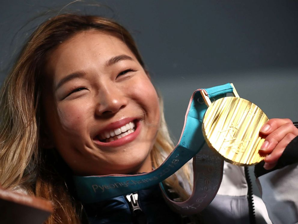 PHOTO: Gold medalist Chloe Kim of the United States poses during the medal ceremony for the Snowboard Ladies Halfpipe Final, Feb. 13, 2018.
