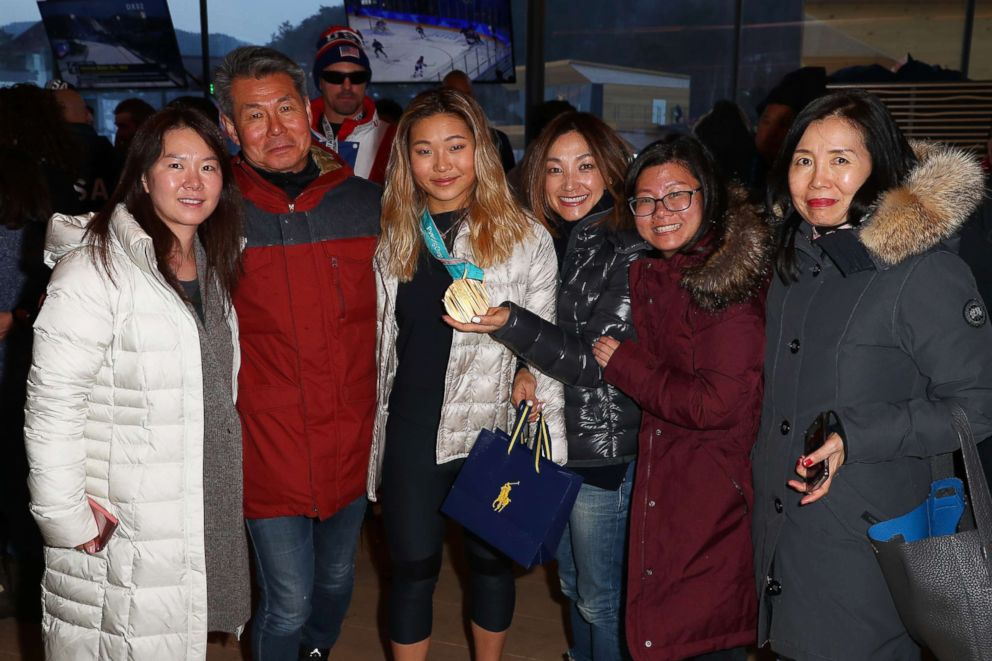 PHOTO: U.S. Olympian Chloe Kim, center with medal, poses for a photo with her family at the USA House at the PyeongChang 2018 Winter Olympic Games, Feb. 14, 2018.