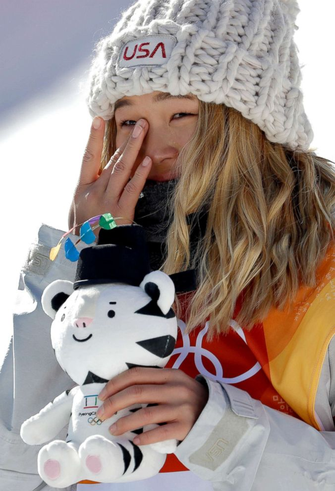 PHOTO: Chloe Kim, of the U.S., wipes away a tear after winning gold in the womens halfpipe finals at Phoenix Snow Park at the 2018 Winter Olympics in Pyeongchang, South Korea, Feb. 13, 2018.