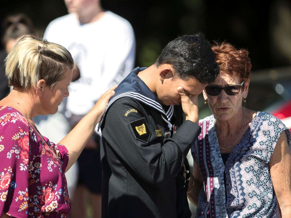 PHOTO: Abdul Iskandar, a sailor of Malaysian Royal Navy, cries after offering flowers outside the Al Noor mosque in Christchurch, New Zealand, March 19, 2019.