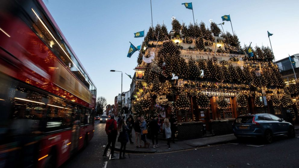 The Churchill Arms pub in London stands adorned with Christmas lights and conifer trees for the Christmas period, Nov. 30, 2018.