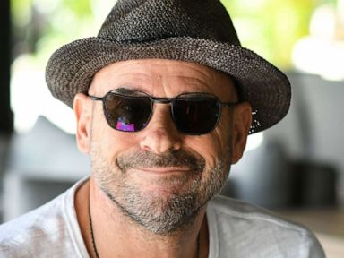 PHOTO: In this file photo taken on July 19, 2019, Guy Laliberte, co-founder of global circus company Cirque du Soleil, poses for a photo on his private island of Nuketepipi in French Polynesia.