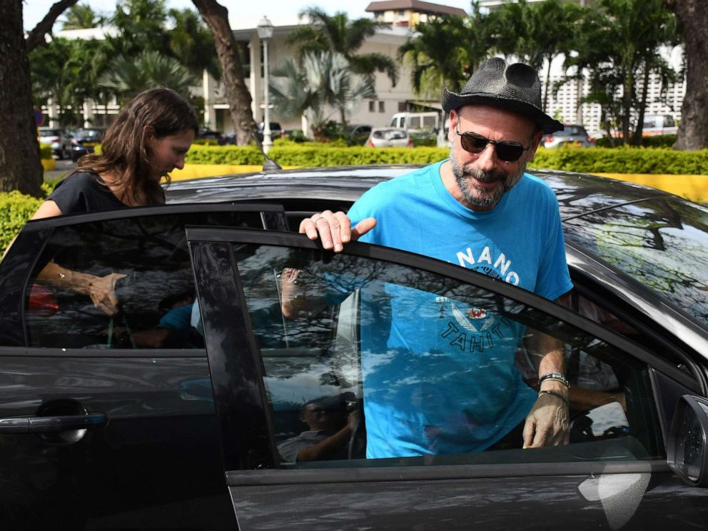 PHOTO: Guy Laliberte, co-founder of global circus company Cirque du Soleil, and Anne Dongois, communication director of Lune Rouge, leave the courthouse of Papeete, French Polynesia, Nov. 13, 2019.