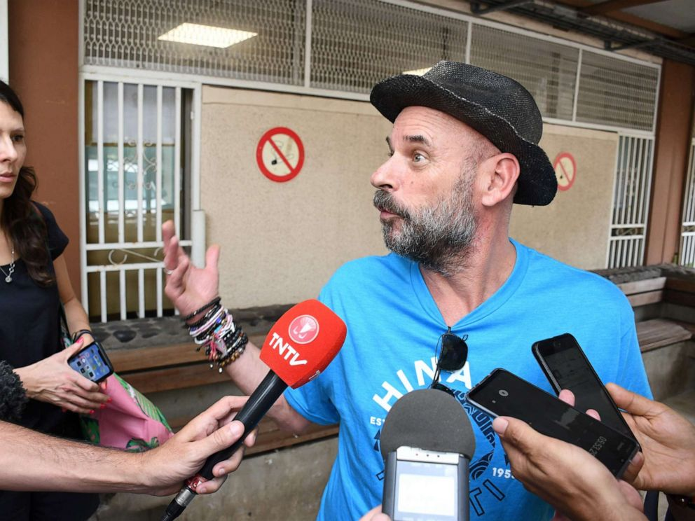PHOTO: Guy Laliberte, billionaire co-founder of global circus company Cirque du Soleil, speaks to the press while Anne Dongois, communication director of Lune Rouge, listens on, as they leave the courthouse of Papeete, French Polynesia, on Nov. 13, 2019.