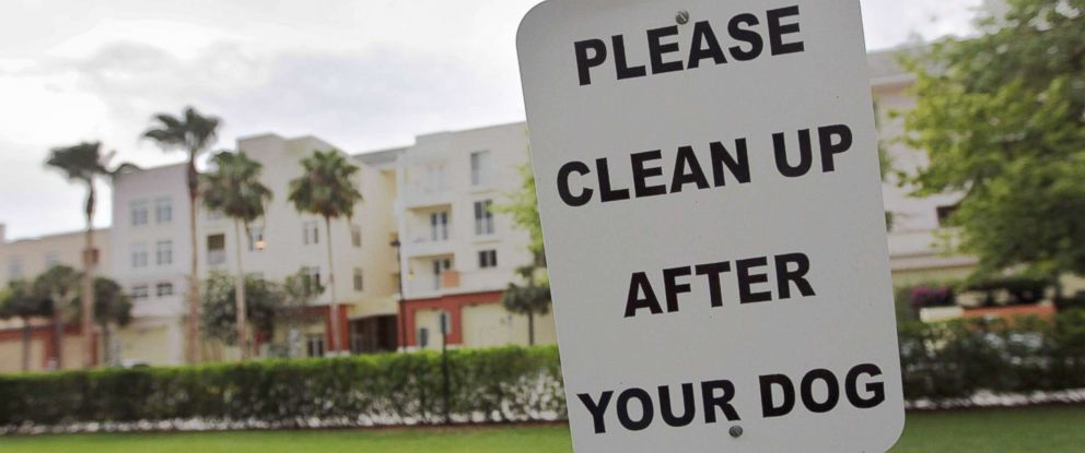 "PHOTO: A sign is posted reading, "" Please clean up after your dog"" in The Village of Abacoa condominium complex in this June 30, 2011 file photo in Jupiter, Fla."