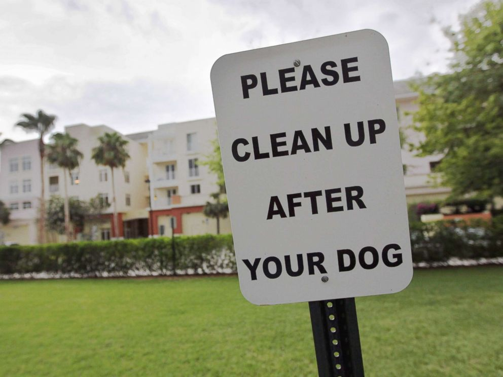 PHOTO: A sign is posted reading, Please clean up after your dog in The Village of Abacoa condominium complex in this June 30, 2011 file photo in Jupiter, Fla.