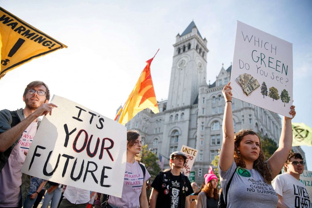PHOTO: Climate change activists with Shut Down DC block rush hour traffic as they walk by the Trump International Hotel during a protest march in Washington, DC, Sept. 27, 2019.