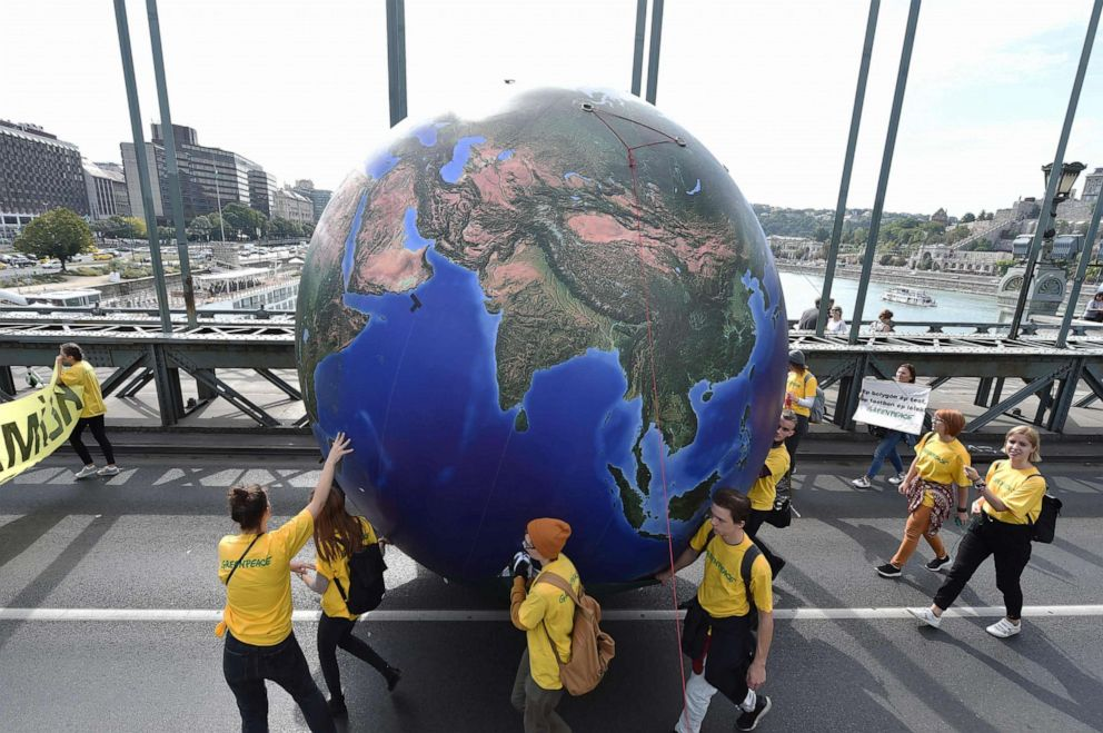 PHOTO: Protesters march with a globe balloon on the oldest Hungarian bridge, the Lanchid (Chain Bridge) during the Global Climate Strike organized by the Fridays For Future Hungary at the end of the global climate change week in Budapest.