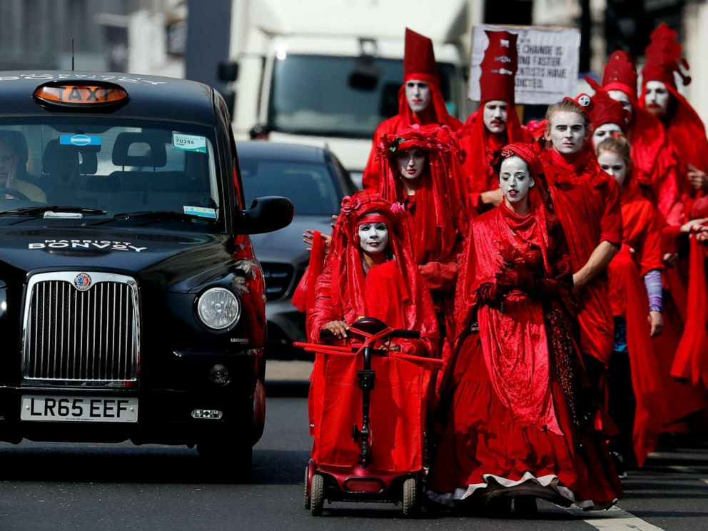 PHOTO: Members of the Red Brigade march in disobedience on the street from Oxford Circus to Piccadilly Circus in London, April 17, 2019.