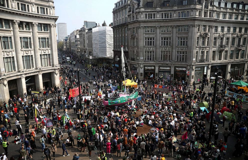 PHOTO: Climate change activists gather at Oxford Circus during the Extinction Rebellion protest in London, April 17, 2019.