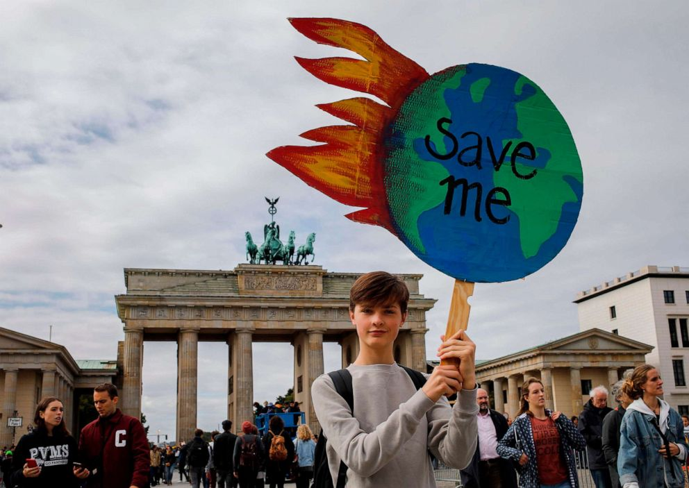PHOTO: A protester holds a globe-shaped sign reading Save Me during the Fridays for Future demonstration in Berlin during a protest for climate action on September 20, 2019, part of a global climate action day.