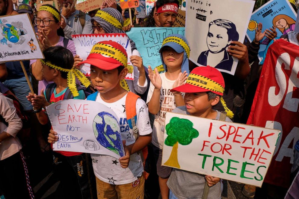 PHOTO: School children participate in a demonstration calling for action on climate change on September 20, 2019, in Jakarta, Indonesia.