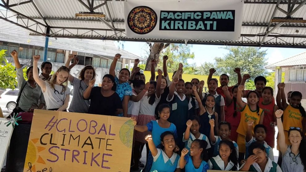 PHOTO: Students from various schools participate in a climate change protest in Tarawa, Kiribati, September 20, 2019 in this picture obtained from social media.