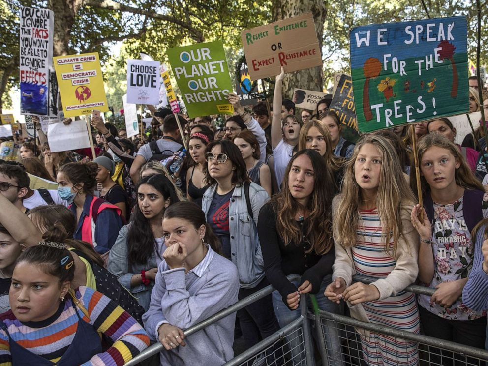 PHOTO: Children listen to speakers as they attend the Global Climate Strike on September 20, 2019, in London.