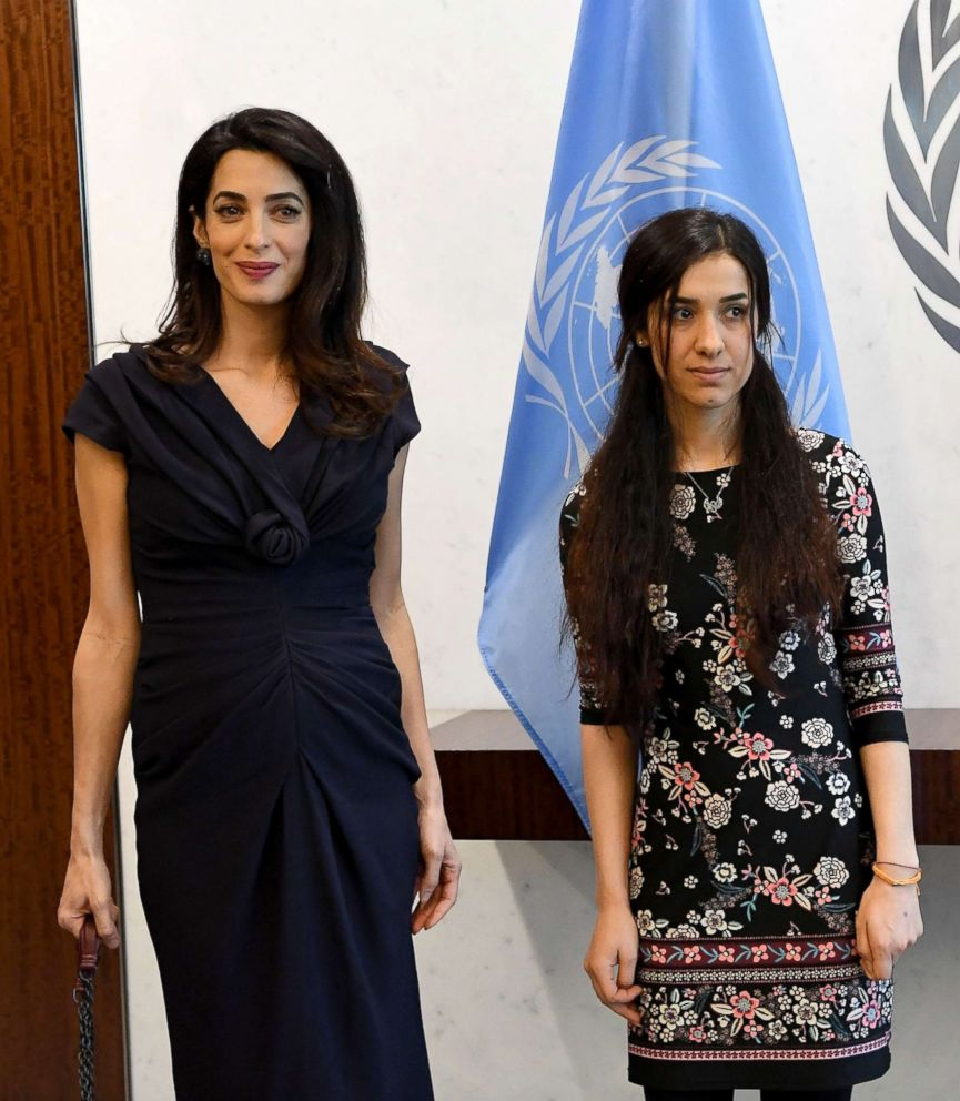 PHOTO: Nadia Murad, right, public advocate for the Yazidi community in Iraq and survivor of sexual enslavement by the Islamic State jihadists, stands next to lawyer Amal Clooney at the UN Headquarters in New York City.