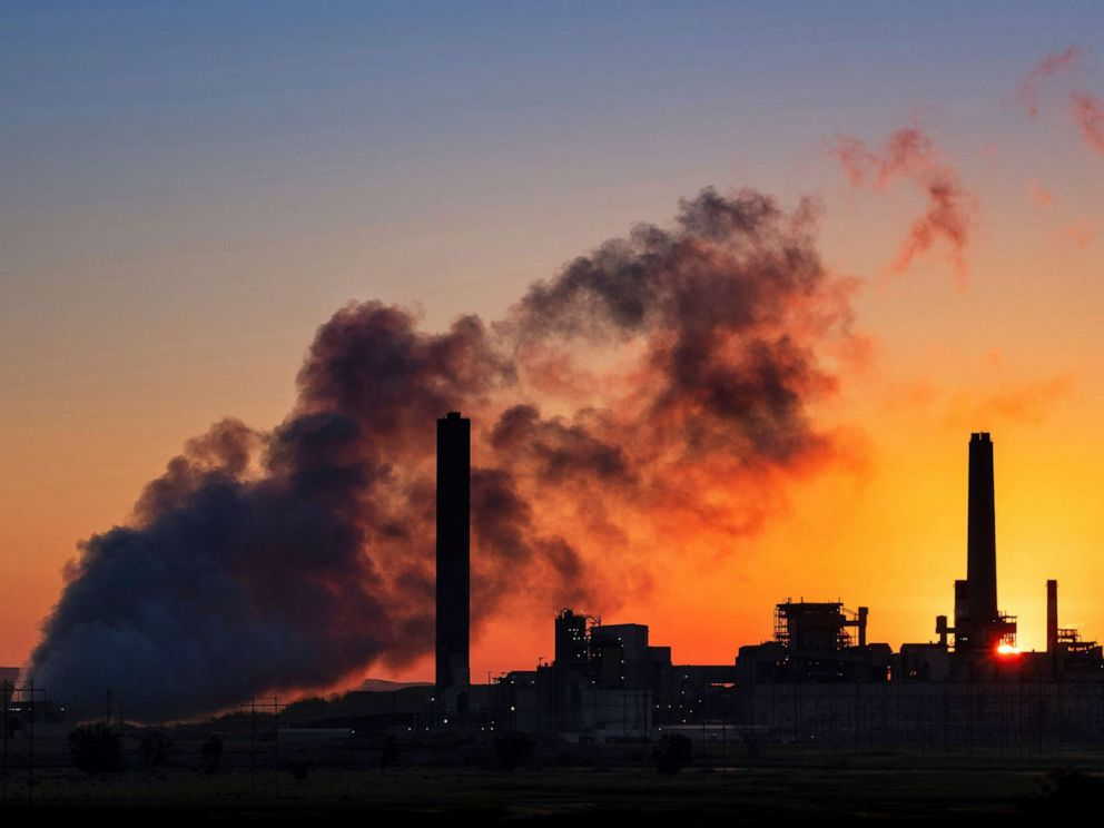 PHOTO: In this July 27, 2018 , file photo, the Dave Johnson coal-fired power plant is silhouetted against the morning sun in Glenrock, Wyo.