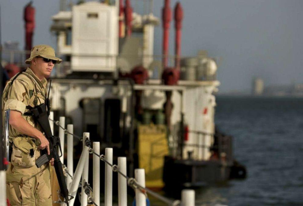PHOTO: Coast Guard Quarter Master Second Class Matt E. Fonville, 22, of Moorehead City, NC., stands watch in Bahrain in 2003.
