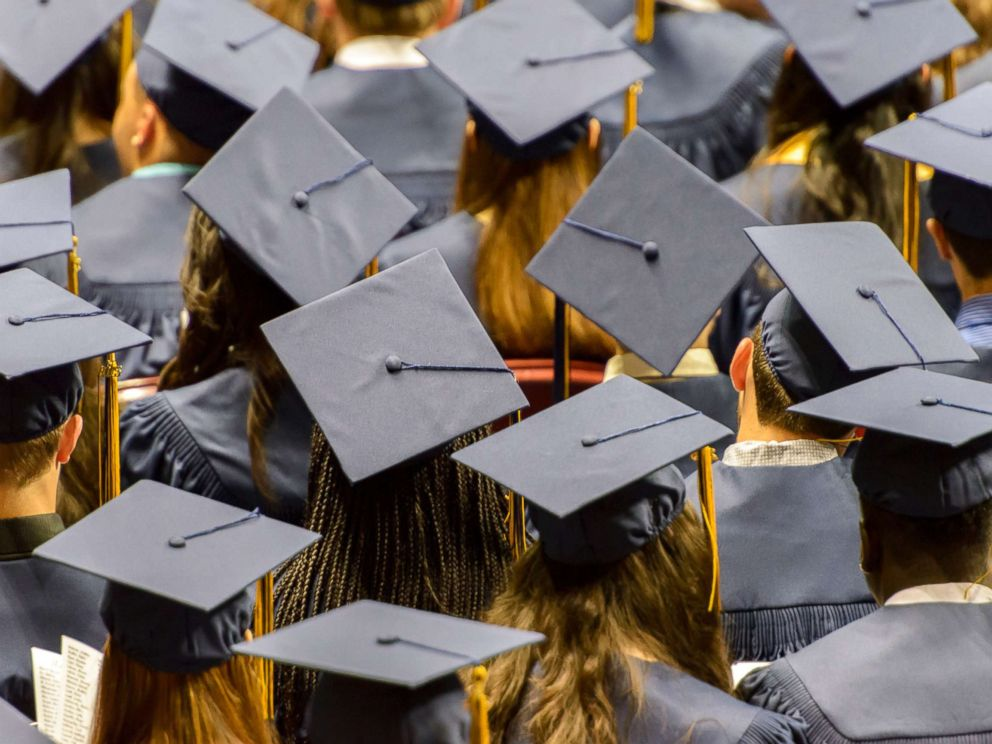 PHOTO: In this undated stock photo shows a group of graduating student wearing caps.