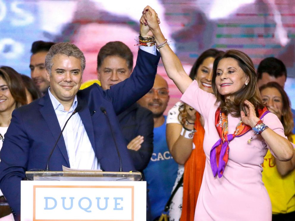 PHOTO: Ivan Duque, presidential candidate for the Democratic Center, left, and his vice presidential formula Marta Lucia Ramirez raise arms after winning the first round presidential election in Bogota, Colombia, May 27, 2018. Deep polarization in Colombia leads to runoff in presidential elections Deep polarization in Colombia leads to runoff in presidential elections colombia election 1 ap er 180529 hpMain 4x3 992