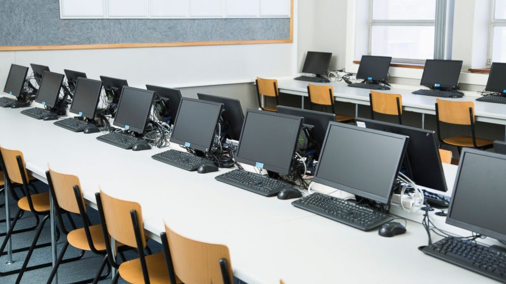 Empty classroom with rows of personal computers on desk pictured in this undated stock photo.