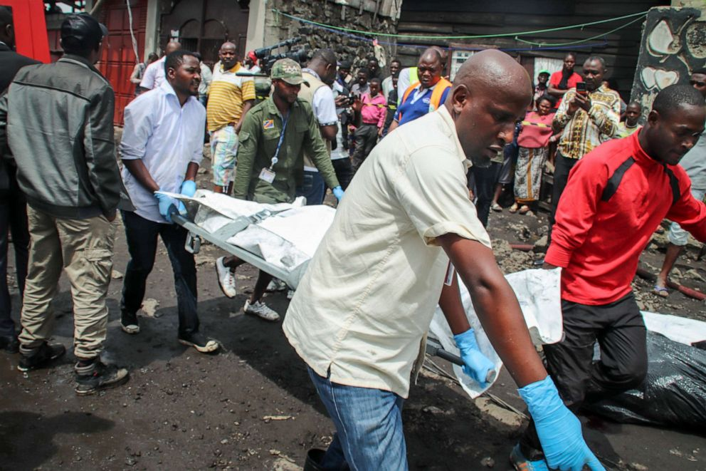 PHOTO: Rescuers remove bodies from the debris of an aircraft operated by private carrier Busy Bee which crashed in Goma, Congo, Nov. 24, 2019.