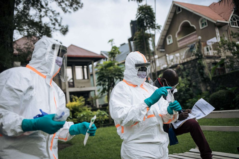 Staff members of the Congolese Ministry of Health perform a COVID-19 test at a private residence in Goma, northeastern Democratic Republic of Congo, on March 31, 2020.Alexis Huguet/AFP via Getty Images, FILE