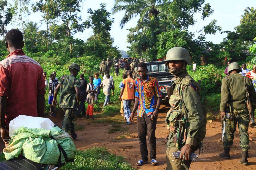 Congolese Soldiers patrol in an area civilians were killed by The Allied Democratic Forces rebels in Beni, Eastern Congo, Oct. 5, 2018. The Congolese military said Sunday Oct. 21, 2018, that rebels attacked an Ebola treatment center in Beni, leaving over a dozen civilians dead and abducted about a dozen children, which could force crucial virus containment efforts to be suspended in the area.
