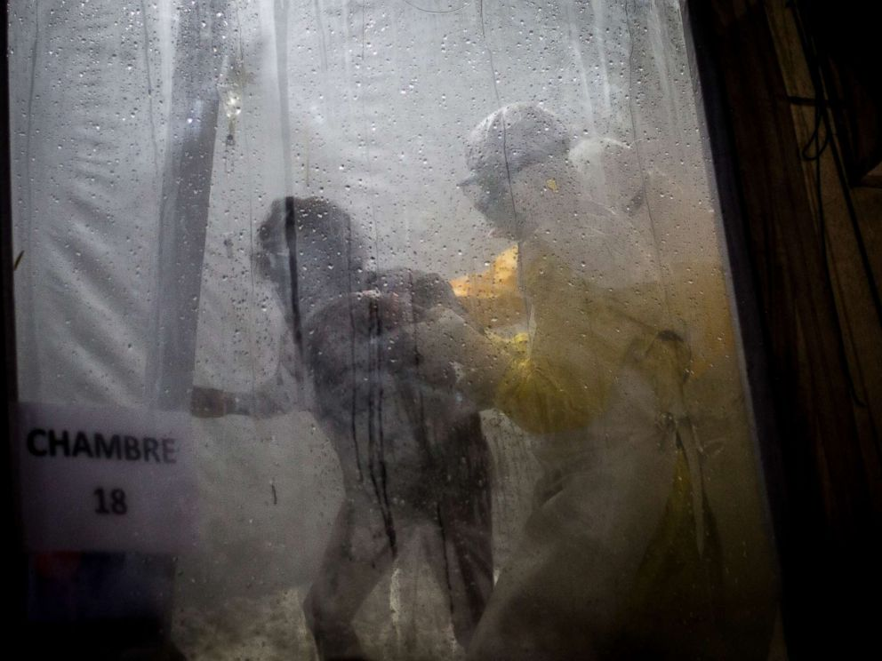 PHOTO: Health workers are seen helping an unconfirmed Ebola patient into her bed inside of a Medecins Sans Frontieres supported Ebola treatment center in Butembo, Congo, Nov. 3, 2018.