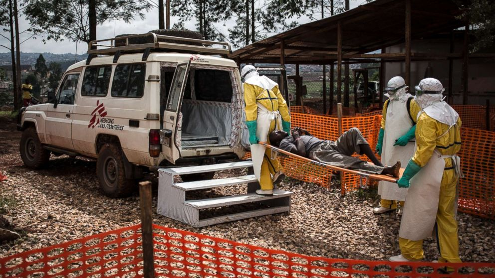 Health workers move a patient to a hospital after he was cleared of having Ebola inside of a Medecins Sans Frontieres supported Ebola treatment center in Butembo, Congo, Nov. 4, 2018.