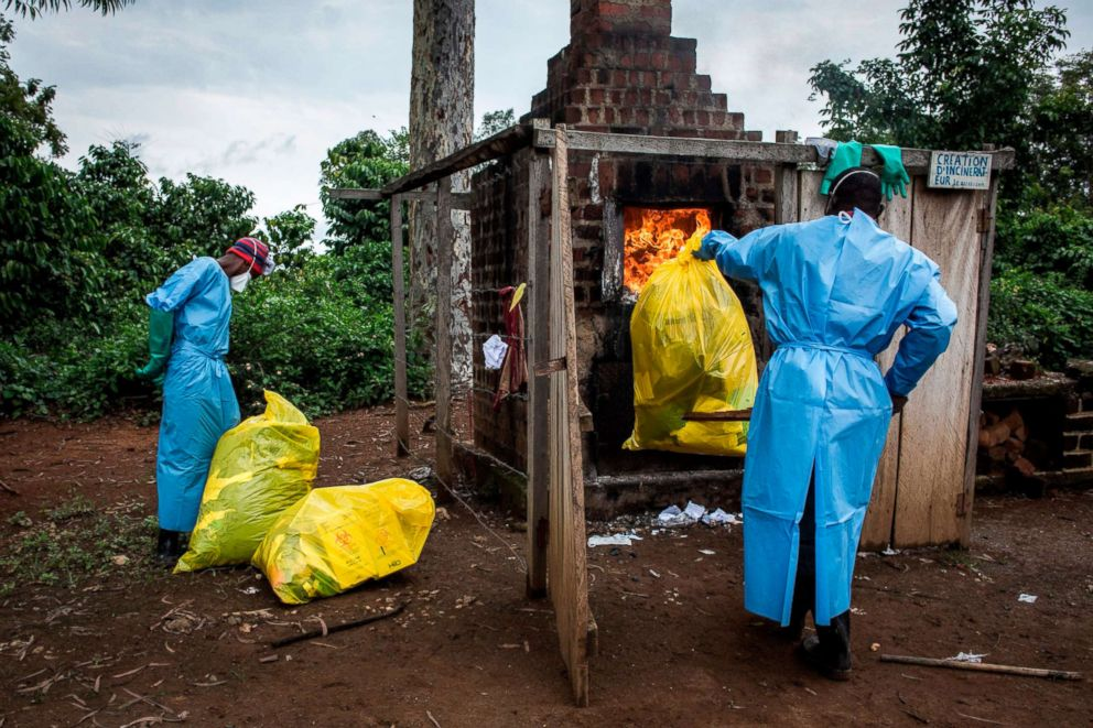 Health workers burn medical waste generated during care of patients with the Ebola virus, Aug. 21, 2018, in Mangina, Democratic Republic of the Congo.