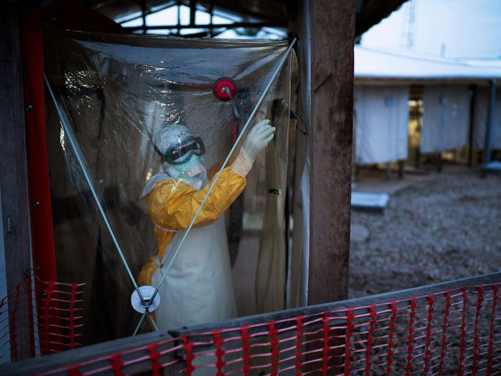 PHOTO: A health worker wearing a protective suit enters an isolation pod to treat a patient at a treatment center in Beni, Democratic Republic of Congo, July 13, 2019.
